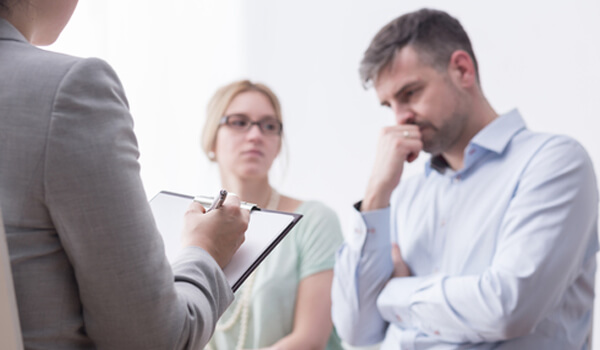 Divorce coach discussing with couple