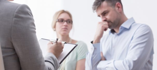 Divorce attorney discussing with couple